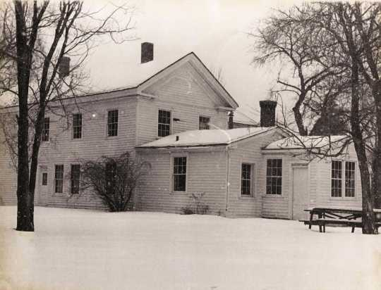 Black and white photograph of the north face of the Banfill Tavern/Locke House, 1978.