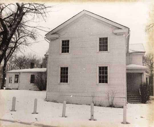 Black and white photograph of the south face of the Banfill Tavern–Locke House showing 1852 addition, 1978.