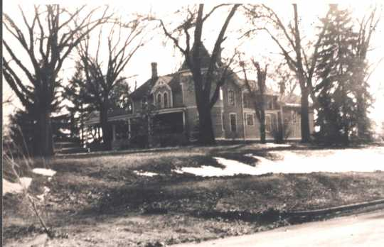 Photograph of the Ticknor House taken in 1972. Interior renovations in 1938 had turned the house into three separate apartments, and divided up and sold much of the Ticknor property that formerly took up the whole block. No further extensive renovations were made until after the house was sold out of the Ticknor family in 1977. Photographer unknown. Anoka County Historical Society, object ID# 3000.3.66.