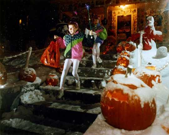 Color image of children trick-or-treating during the Halloween Blizzard, 1991. Photograph by Brian Peterson, Minneapolis Star Tribune.