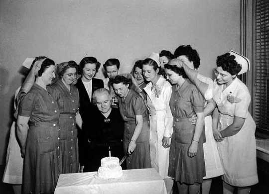 Sister Kenny Institute staff help Sister Kenny celebrate Institute's first birthday.