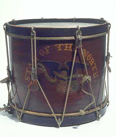 Image of hand-painted drum composed of a walnut-stained wood shell and black hoops with rope tuning cords.