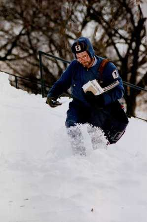 Color image of a mailman working after the Halloween Blizzard, 1991. Photograph by Stormi Greener, Minneapolis Star Tribune.