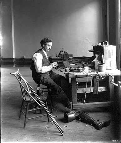 Black and white photograph of E. H. Erickson making artificial limbs, 1904.