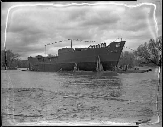 Black and white photograph of the launching of the Agawam at Savage, 1943. Photograph by Minneapolis Star Journal.