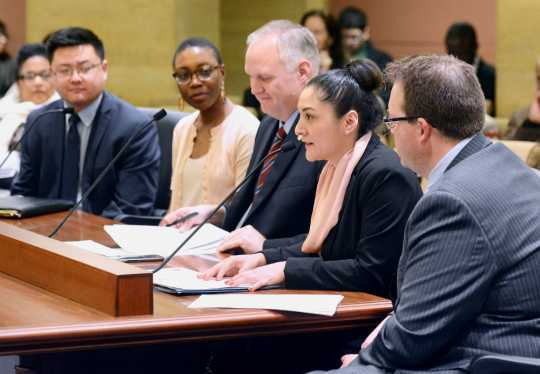Color image of MCLA staff member Violeta Hernández Espinosa testifies during the SF1585 hearing, 2017. Used with the permission of the Minnesota Council on Latino Affairs.