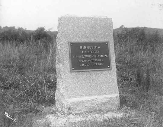 Photograph of a rectangular stone monument with metal plaque honoring the Fourth Minnesota regiment
