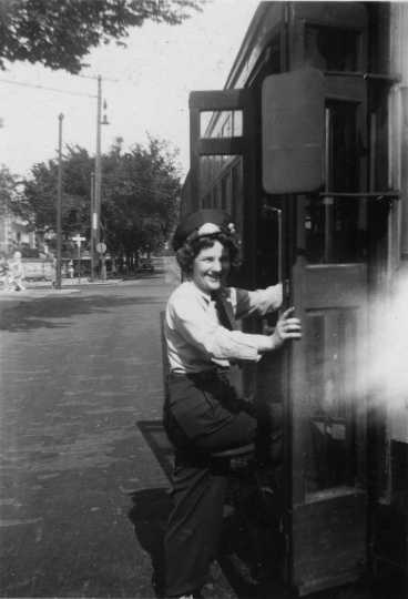 Photograph of motorette boarding a streetcar