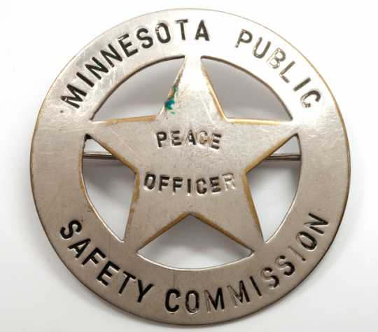 """Color image of Minnesota Commission of Public Safety """"Peace Officer"""" badge."""