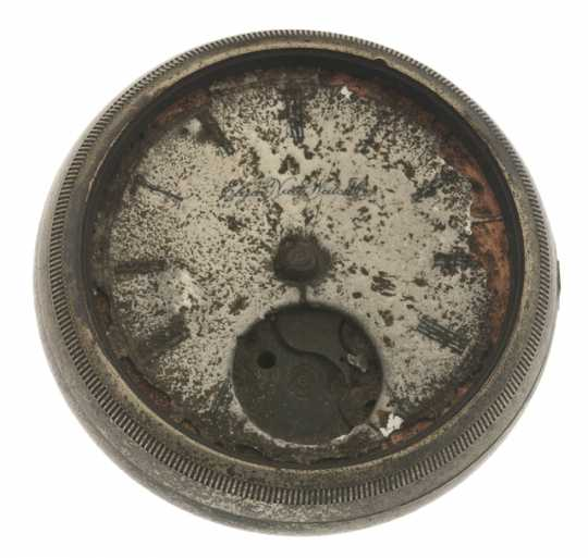 A pocket watch taken from the hand of a victim of the Great Hinckley Fire of 1894. The watch has a silver alloy case and a white porcelain face. Manufactured in 1884 by the Elgin National Watch Company of Elgin, Illinois.