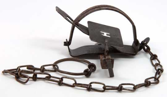 Color image of a steel animal trap used by the Hudson's Bay Company.