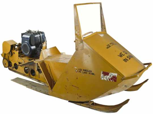 1961 Polaris Sno-Traveler. This snowmobile was originally painted red and was decorated with white stenciling, decals, and pinstripes.