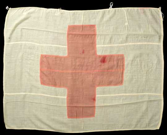 Color image of a Red Cross Flag carried by Theresa Ericksen to the Philippines during the Spanish–American War and to France during World War I.