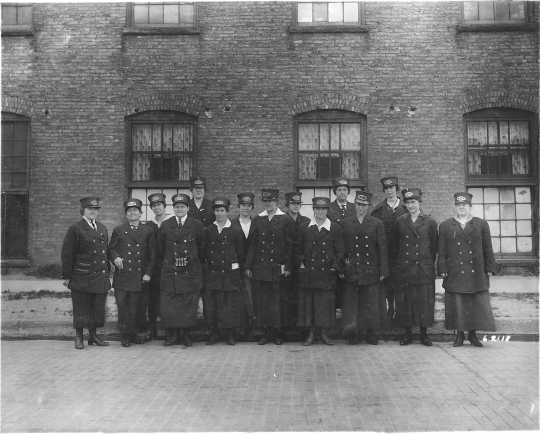 photograph of a group of uniformed streetcar conductresses