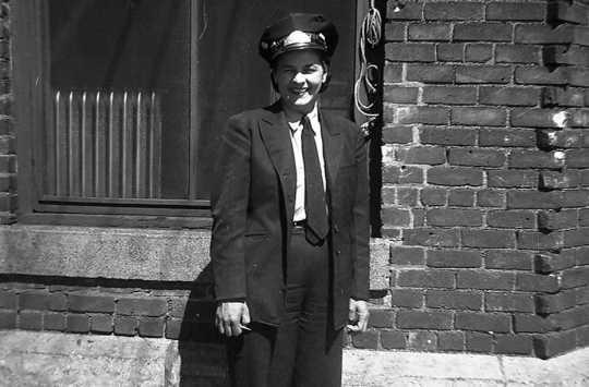 photograph of uniformed motorette