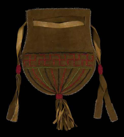 Color image of a fringed and beaded Dakota bag with drawstring closure created in the 1930s for sale to tourists.