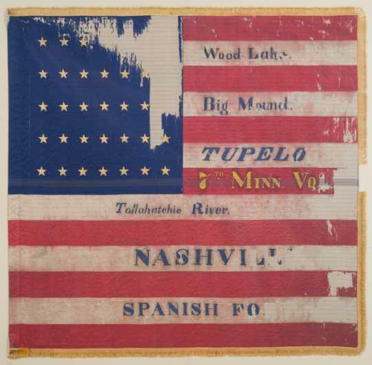 Tattered battle flag of the Seventh Minnesota Infantry Regiment.