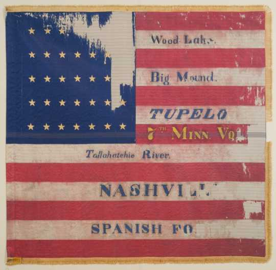 Tattered battle flag of the Seventh Minnesota Infantry Regiment.