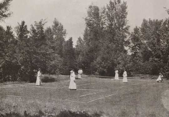 Black and white photograph of the Graham Hall tennis courts, ca. 1908.