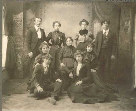 Black and white photograph of Mrs. Schmitt and family, c.1895.