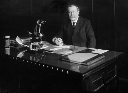 Black and white photograph of Lawrence S. Donaldson at his desk, c.1920. Photograph by C.J. Hibbard.
