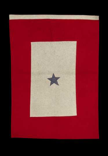 Color image of a red and white felt service flag with one blue star, used by the family of Harvey Mears, who served in World War I and World War II, ca. 1915–1943.