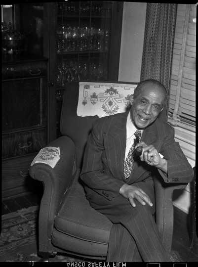 S. Edward Hall of St. Paul sitting for a portrait. ca. 1940.