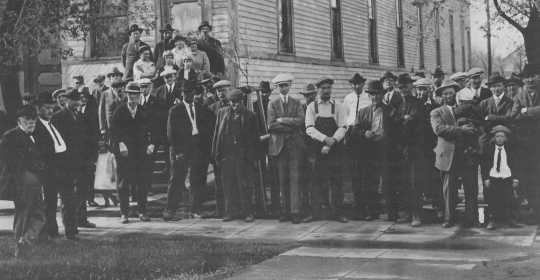 Black and white photograph of locals attending a meeting at the Northwest Experiment Station.