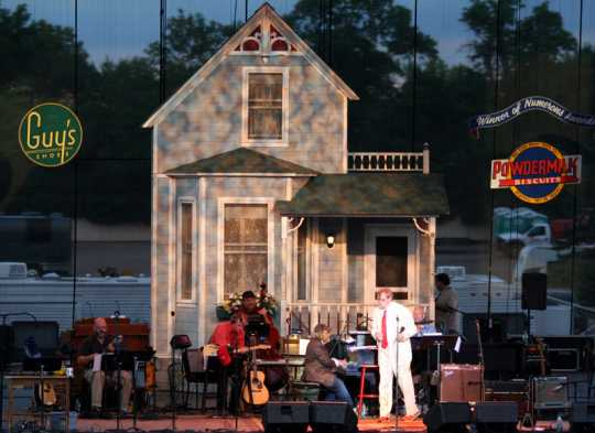 : Garrison Keillor and the Guy's All-Star Shoe Band on stage at the 2011 Minnesota State Fair before a live performance.