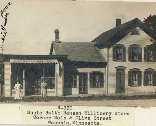 Black and white photograph of Susie Schmitt Hanson's  millinery store, on the corner Main and Olive in Waconia.