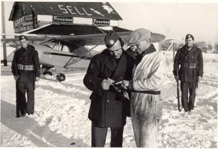Black and white photograph of Elmer Sell and others at Sell Airfield.