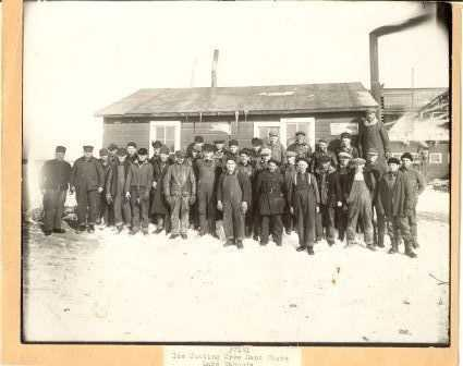 Black and white photograph of an ice Cutting Crew on East Shore of Lake Waconia, c.1920.