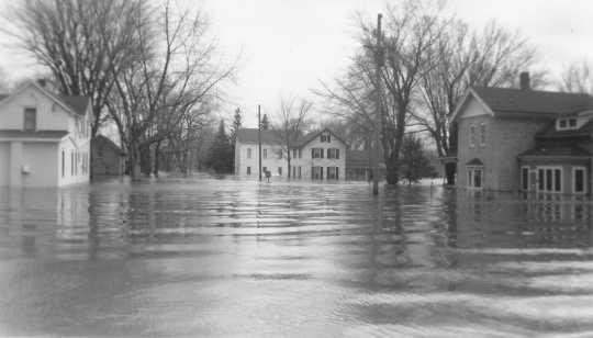 Black and white photograph of flood at Chaska, 1965