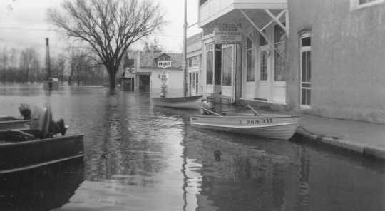 Black and white photograph of flood at Chaska, 1965. Photographed by Les Melchert.