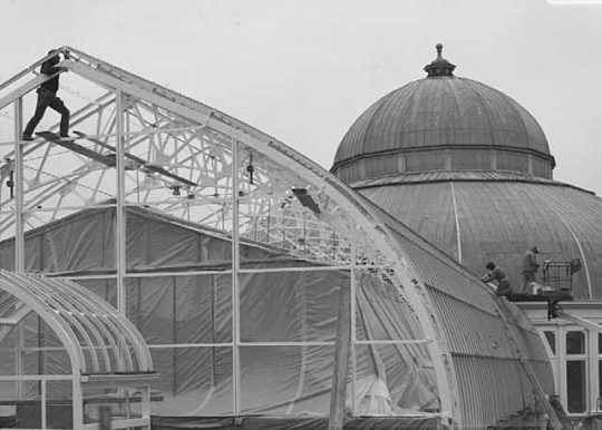 Black and white photograph of restoration work on the Conservatory, 1990.