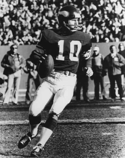 Black and white photograph of Fran Tarkenton (#10) quarterback for the Minnesota Vikings, ca. 1975.