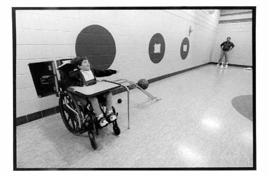 Third grader training for the Special Olympics bowling competition with her adaptive physical education teacher, Joe Mangini, at Cuyuna Range Elementary School in Crosby, Minnesota, 1998.