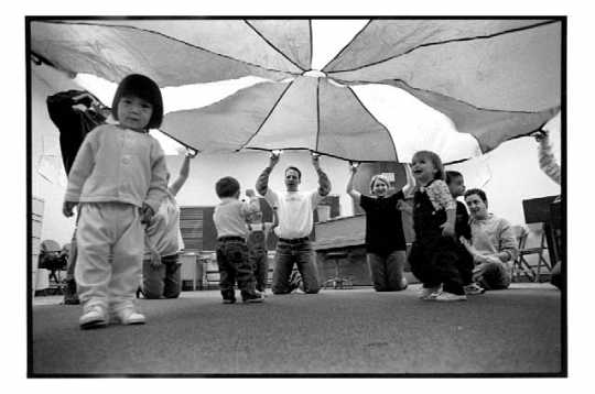 """Music for Creepers & Toddlers"" class. Photograph by George Byron Griffiths, April 24, 1999. The early childhood music education class for parents and their nine-to-twenty-three-month-old children was held at the MacPhail Center for the Arts in Minneapolis."