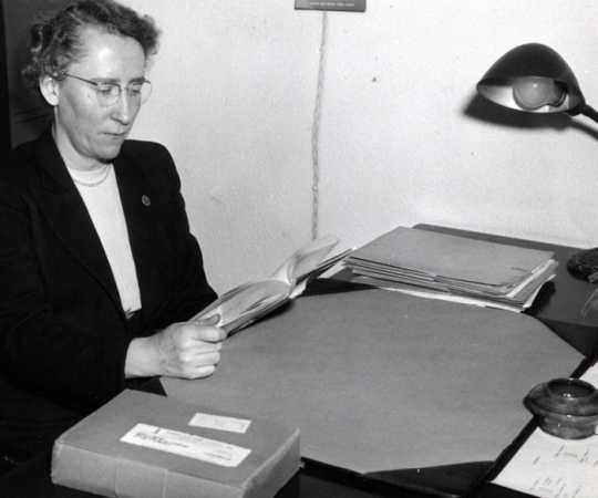 Black and white photograph of Agnes Keenan in her office, c.1950. From the Agnes Keenan Collection. St. Catherine University Archives, St. Paul.