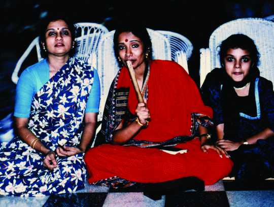 Seated group photograph of Ranee Ramaswamy, Alarmél Valli, and Aparna Ramaswamy