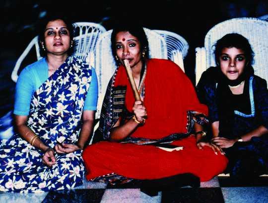 Seated group photograph of Ranee Ramaswamy, Alarmél Valli, and Aparna Ramaswamy