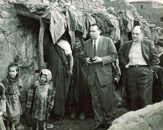 Black and white photograph of the executive director of the United Jewish Federation Council of St. Paul and the executive director of the Jewish Federation Council of Kansas City visit a home in Ourika, Morocco during a tour of conditions of Jews in North Africa, undated.