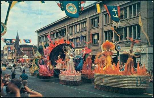 Parade floats passing down a Minneapolis Street for Aquatennial's Grande Day Parade, 1960.