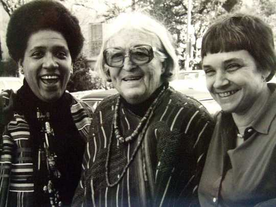 Black and white photograph of left to right: Audre Lorde, Meridel Le Sueur, and Adrienne Rich, c.1980.