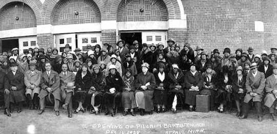 Black and white photograph of the Congregation in front of Pilgrim Baptist Church on opening day (December 16, 1927), 732 West Central Avenue, St. Paul.