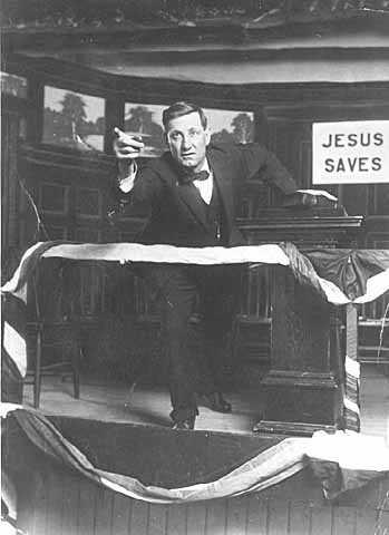 Photograph of Reverend John Sornberger, a lumberjack sky pilot, preaching c.1930.