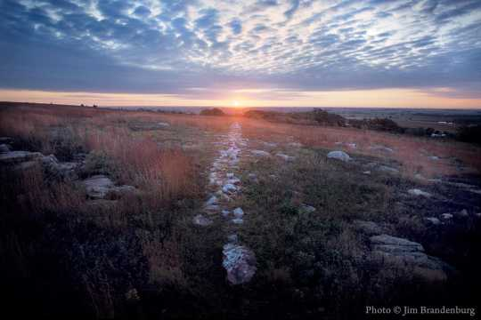 Color image of a sunrise during the autumnal equinox in Blue Mounds State Park, 1990.