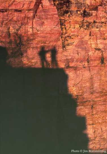 Color image showing shadows of visitors to Blue Mounds Quarry, 1995.