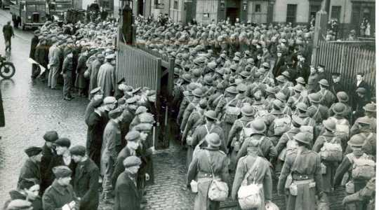 Black and white photograph of the Thirty-fourth Infantry Division arriving in Belfast, Northern Ireland, 1942.