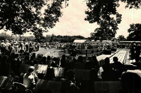 Black and white photograph of the bicentennial kick-off celebration featuring Lieutenant Governor Rudy Perpich at End-o-Line Railroad Park, July 1976.